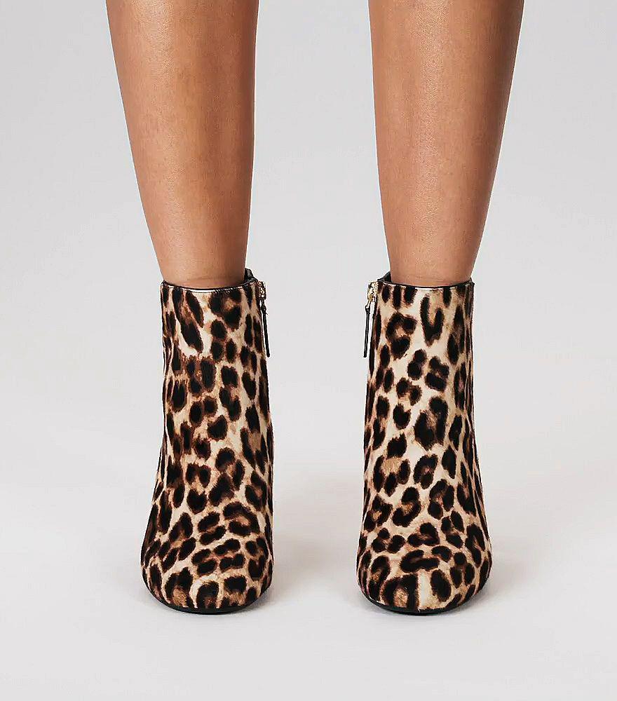 5dc66206f64d Lyst - Tory Burch Woman Bow-detailed Leopard-print Calf Hair Ankle ...