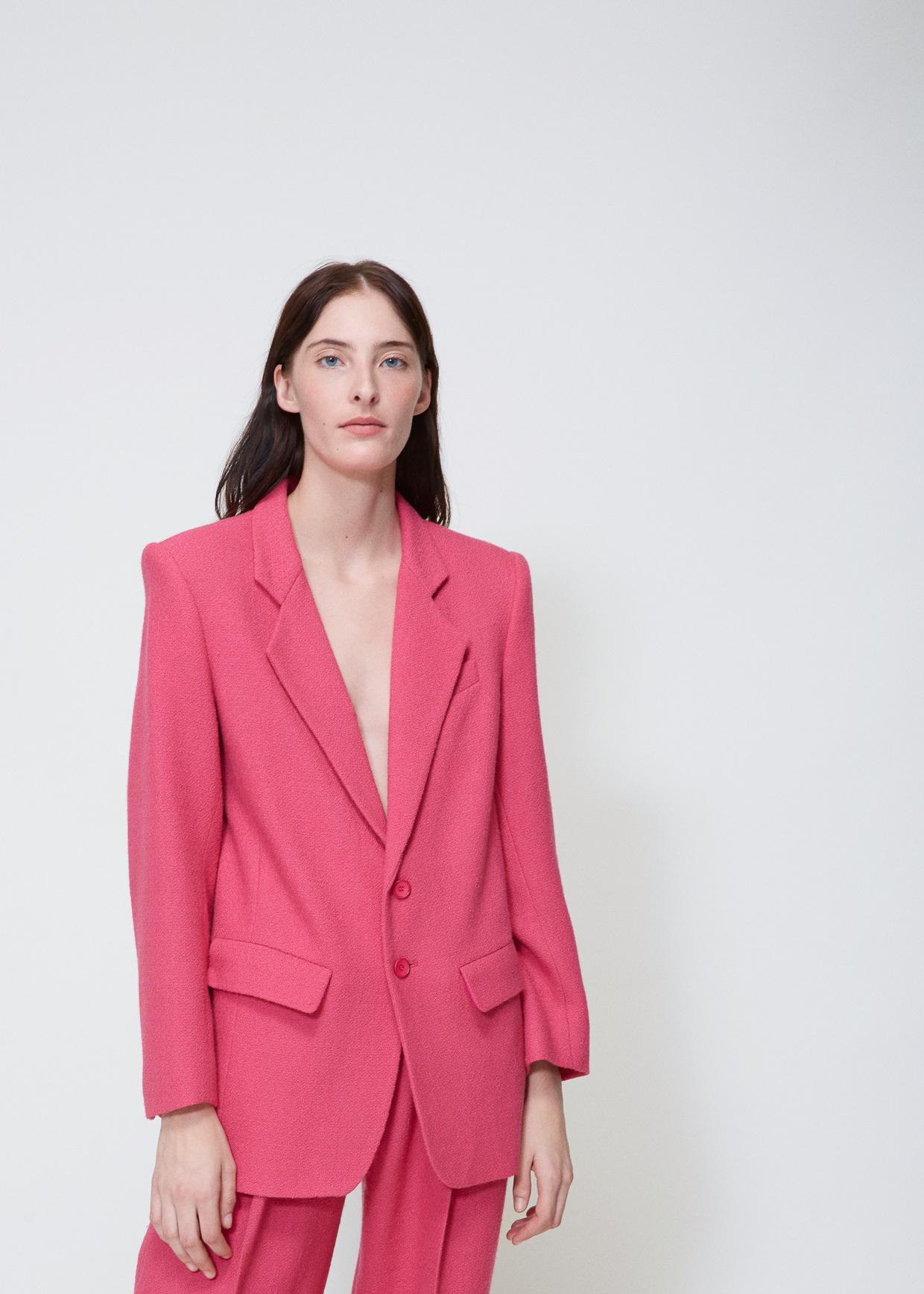 An eye-catching blazer constructed of metallic stretch twill with peaked shoulders, ruched 3/4-length sleeves, princess seams and a back peplum detail. The lapel has a hook-and-eye closure in the front.