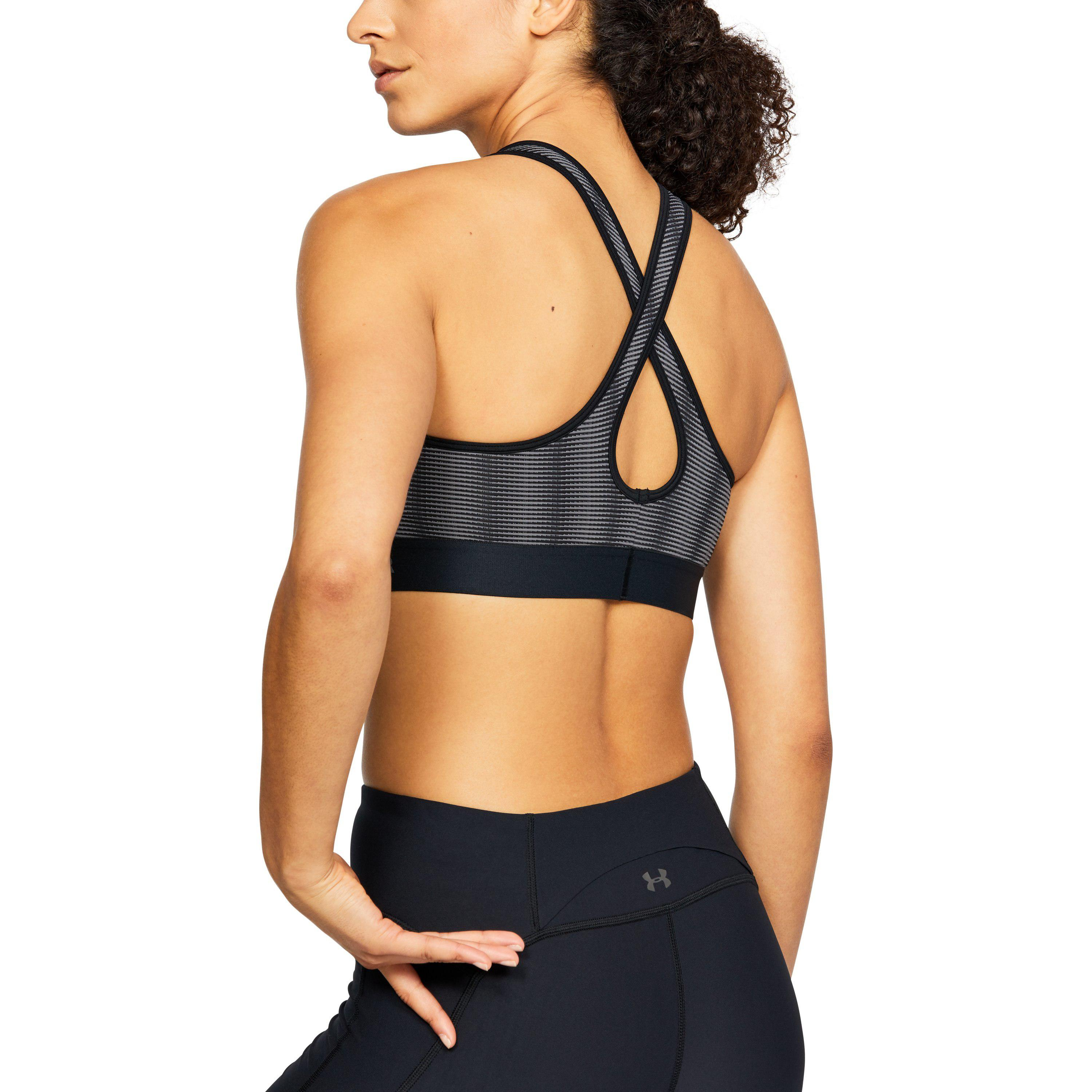 734ab5b969 Lyst - Under Armour Women s Armour® Mid Crossback Patterned Sports ...