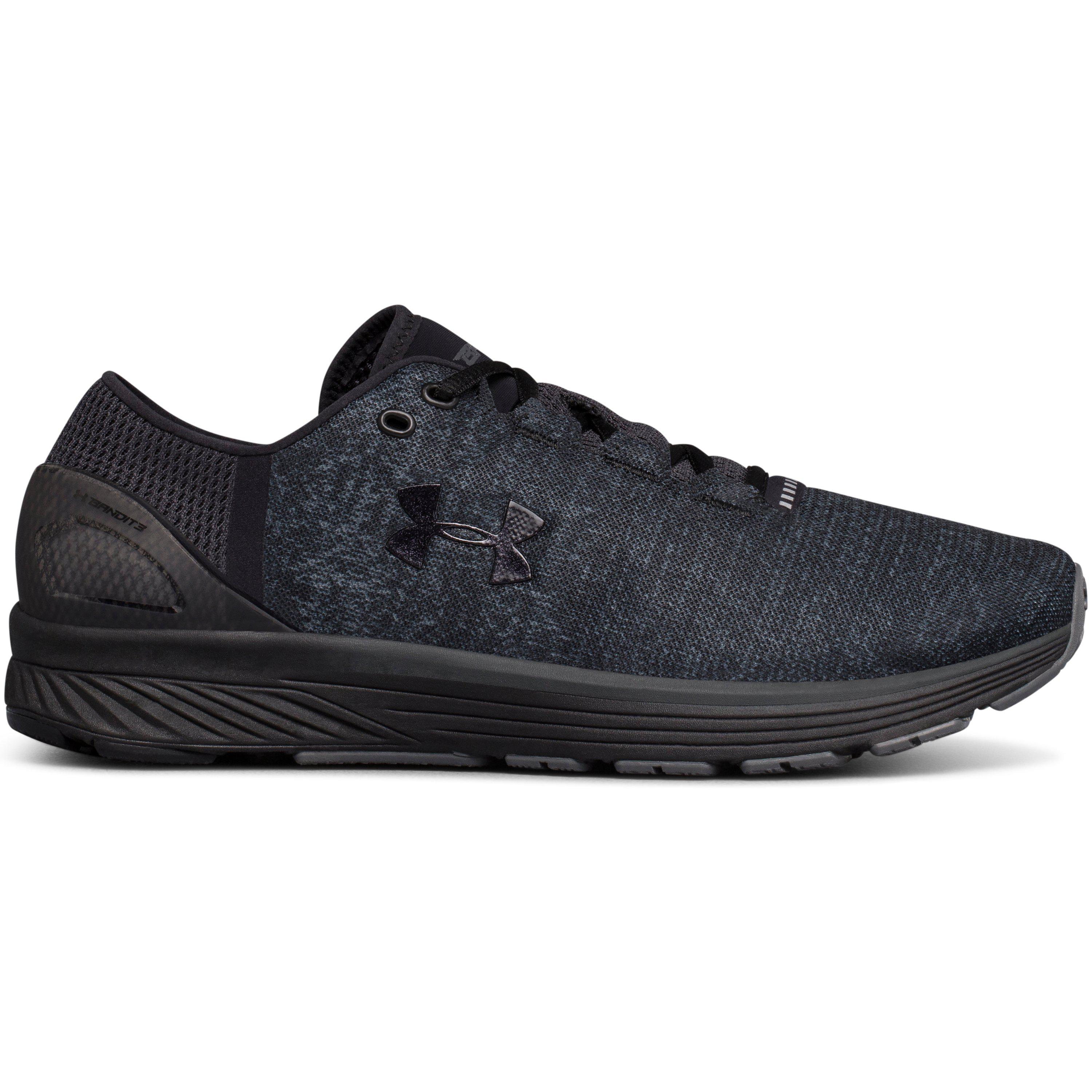 Under Armour CHARGED BANDIT 4 - Neutral running shoes - white/black Ip8e4