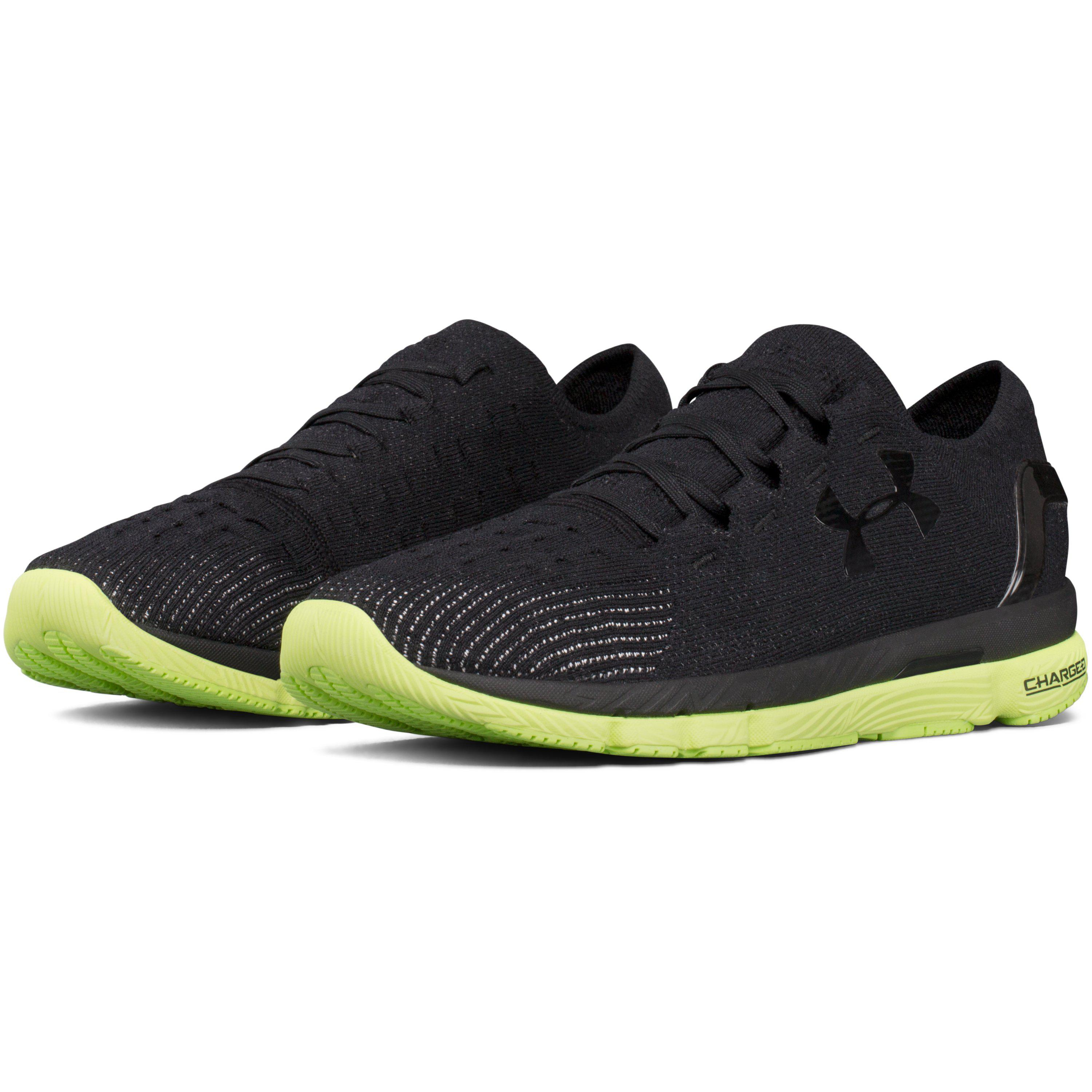 green and black under armour shoes off