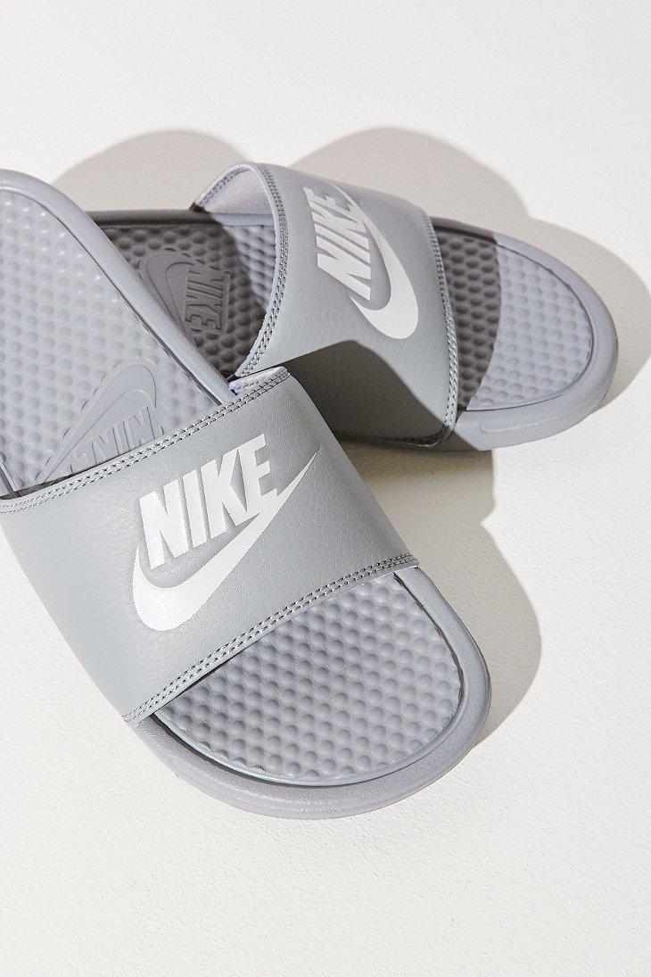 gray nike slides womens