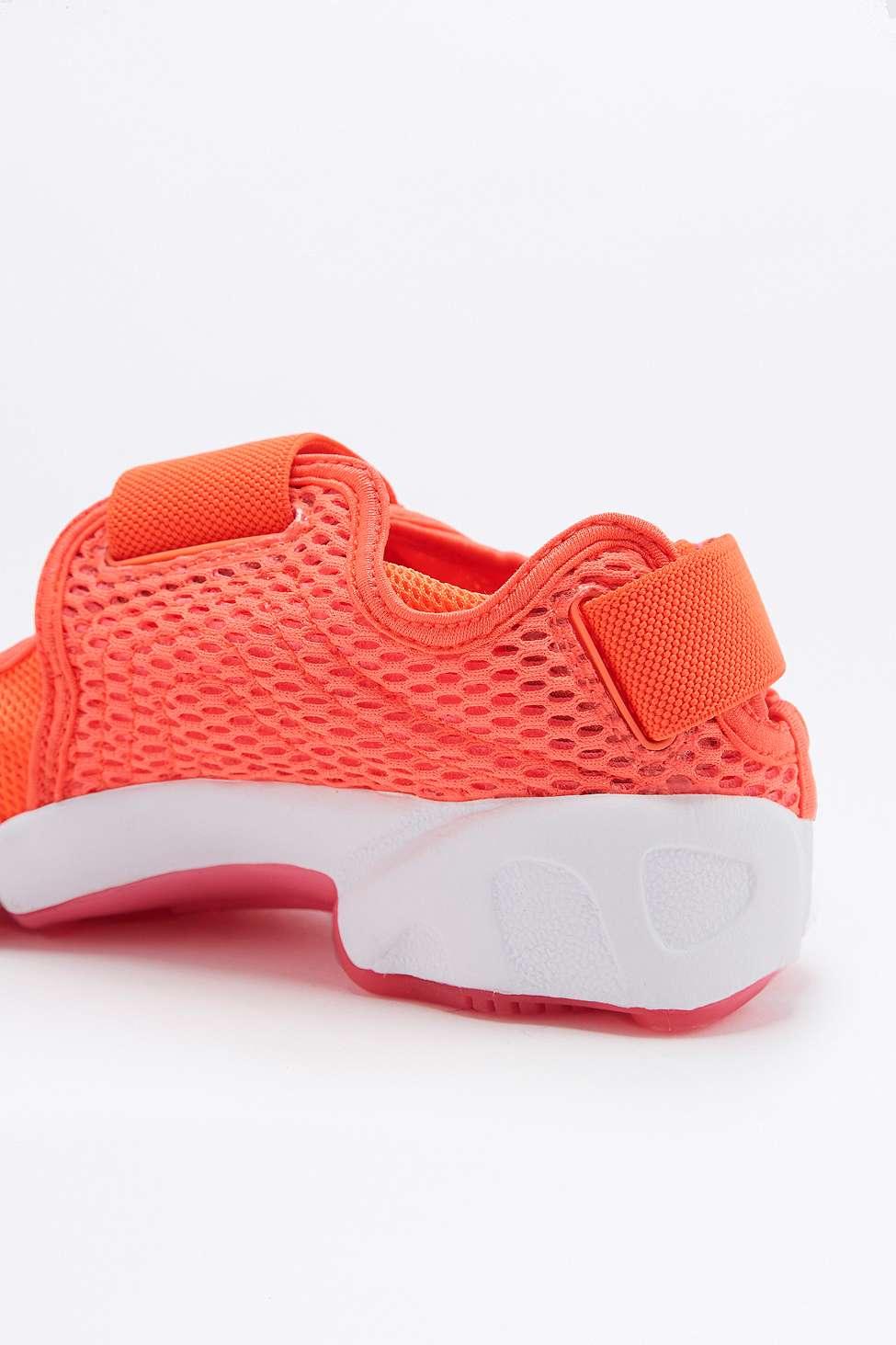 Nike Air Rift Coral Trainers