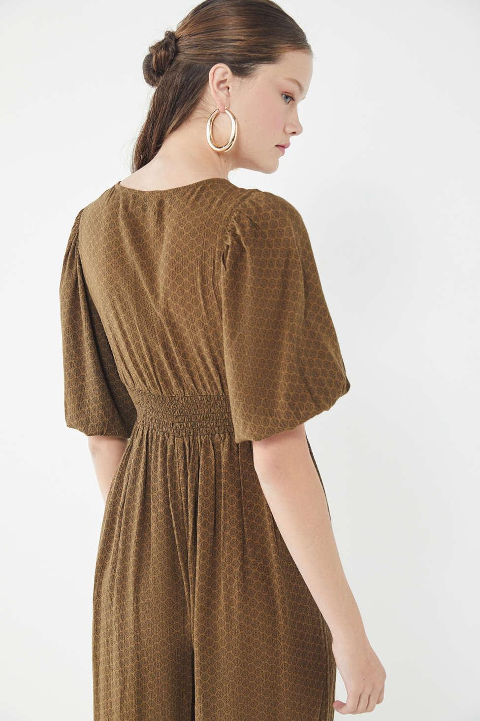 3d33bea04257 Lyst - Urban Outfitters Uo Zimi Plunging Puff Sleeve Jumpsuit