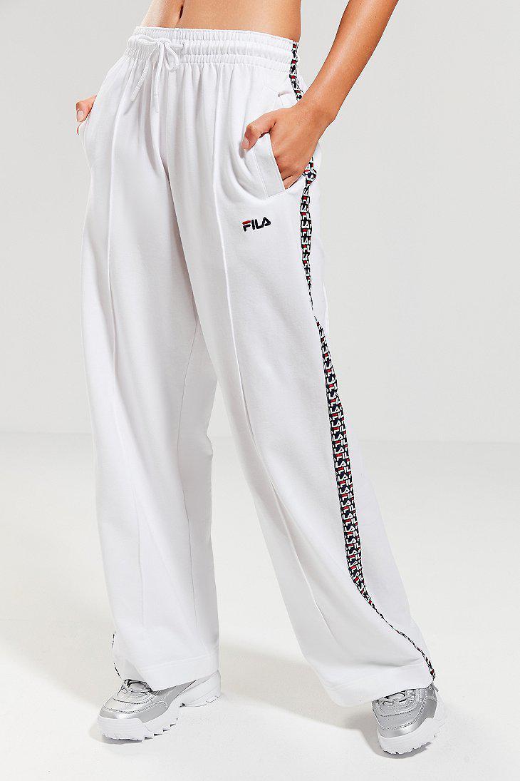 bc57a70b9b84 Fila Fila + Uo Lara Logo Stripe Track Pant in White - Lyst
