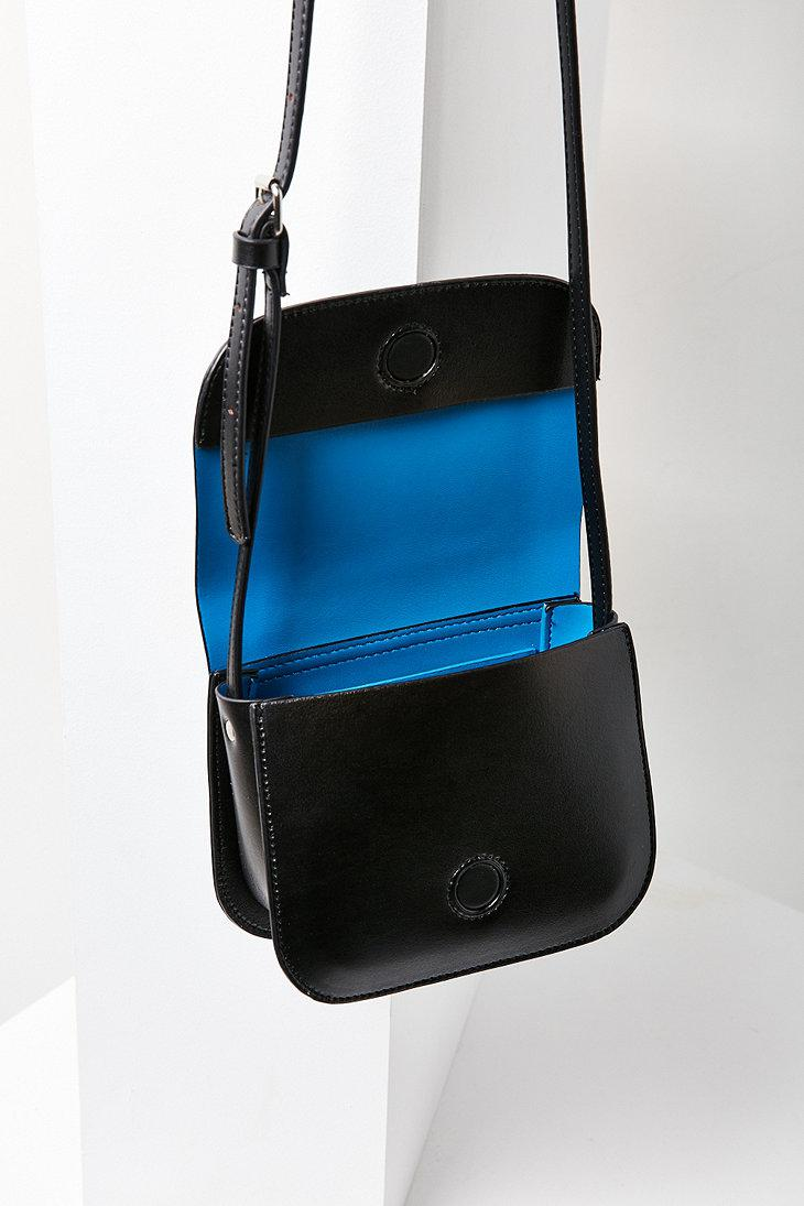 Urban Outfitters Sheryl Saddle Crossbody Bag in Black