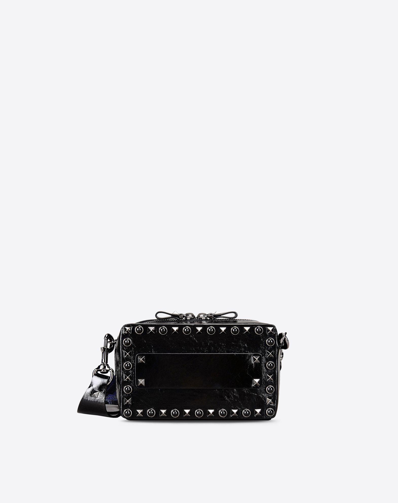 valentino guitar rockstud rolling noir small leather cross body bag in black lyst. Black Bedroom Furniture Sets. Home Design Ideas