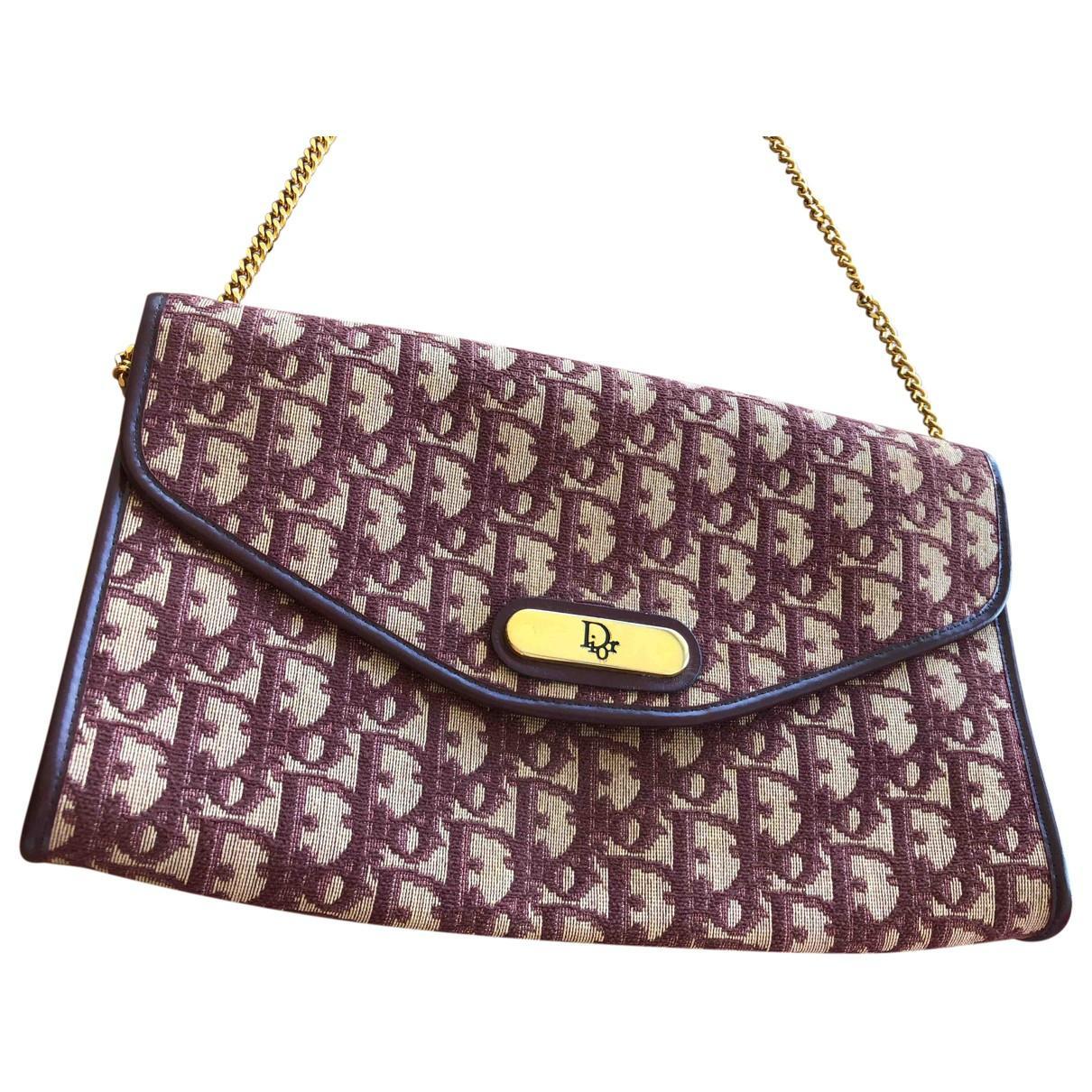 68890868fd15 Dior Pre-owned Cloth Clutch Bag in Purple - Lyst