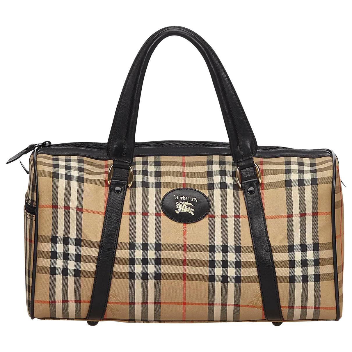 Lyst - Burberry Pre-owned Cloth Travel Bag in Brown 95cd44ee3a684