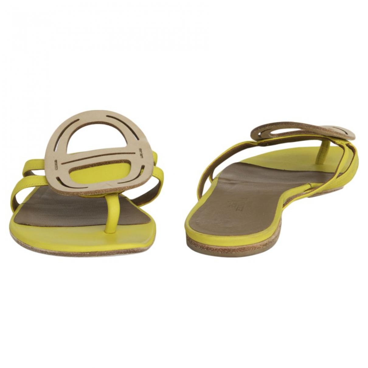 0044932f2eff Hermès Yellow Leather Sandals in Yellow - Lyst