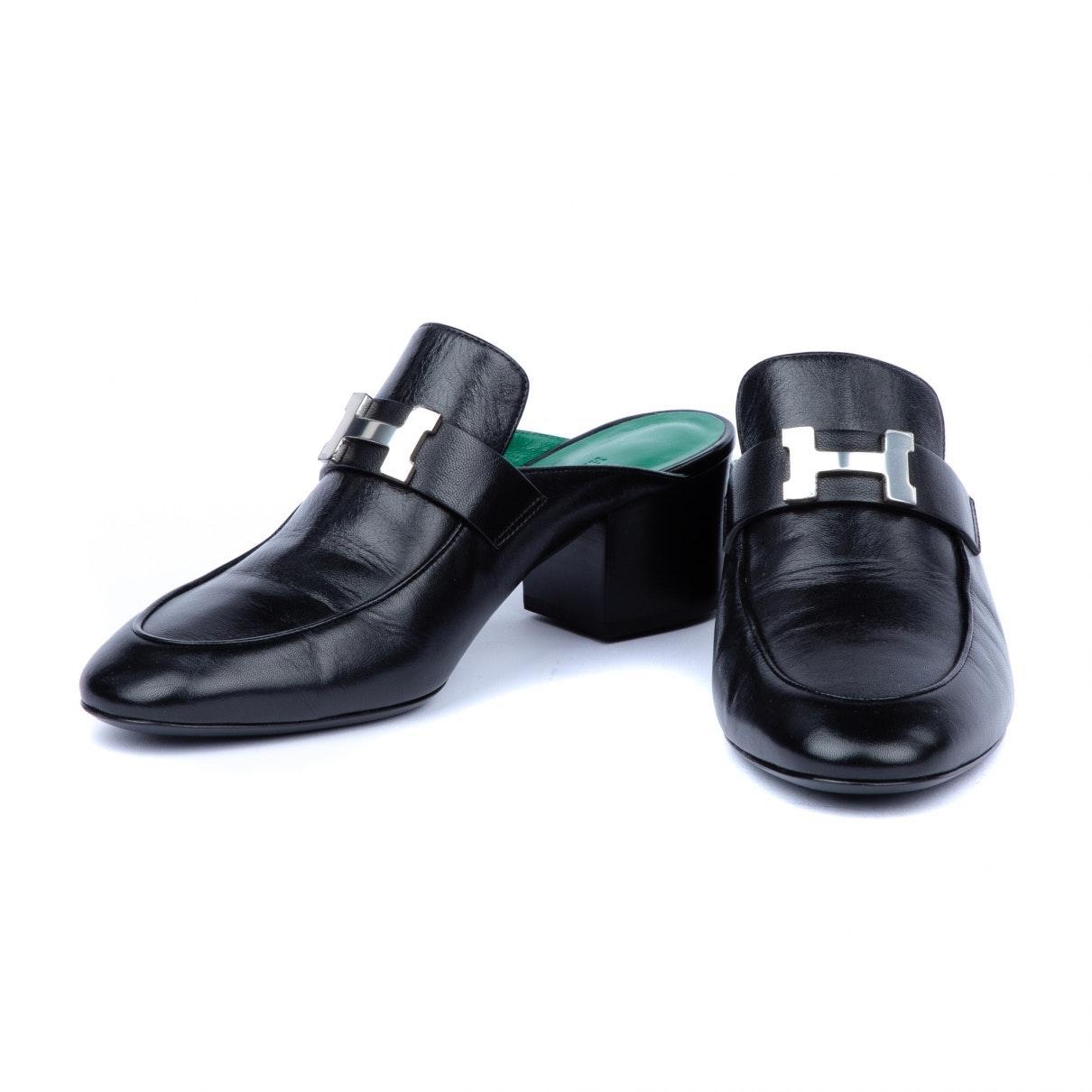 Zuecos de Cuero Hermès de color Negro