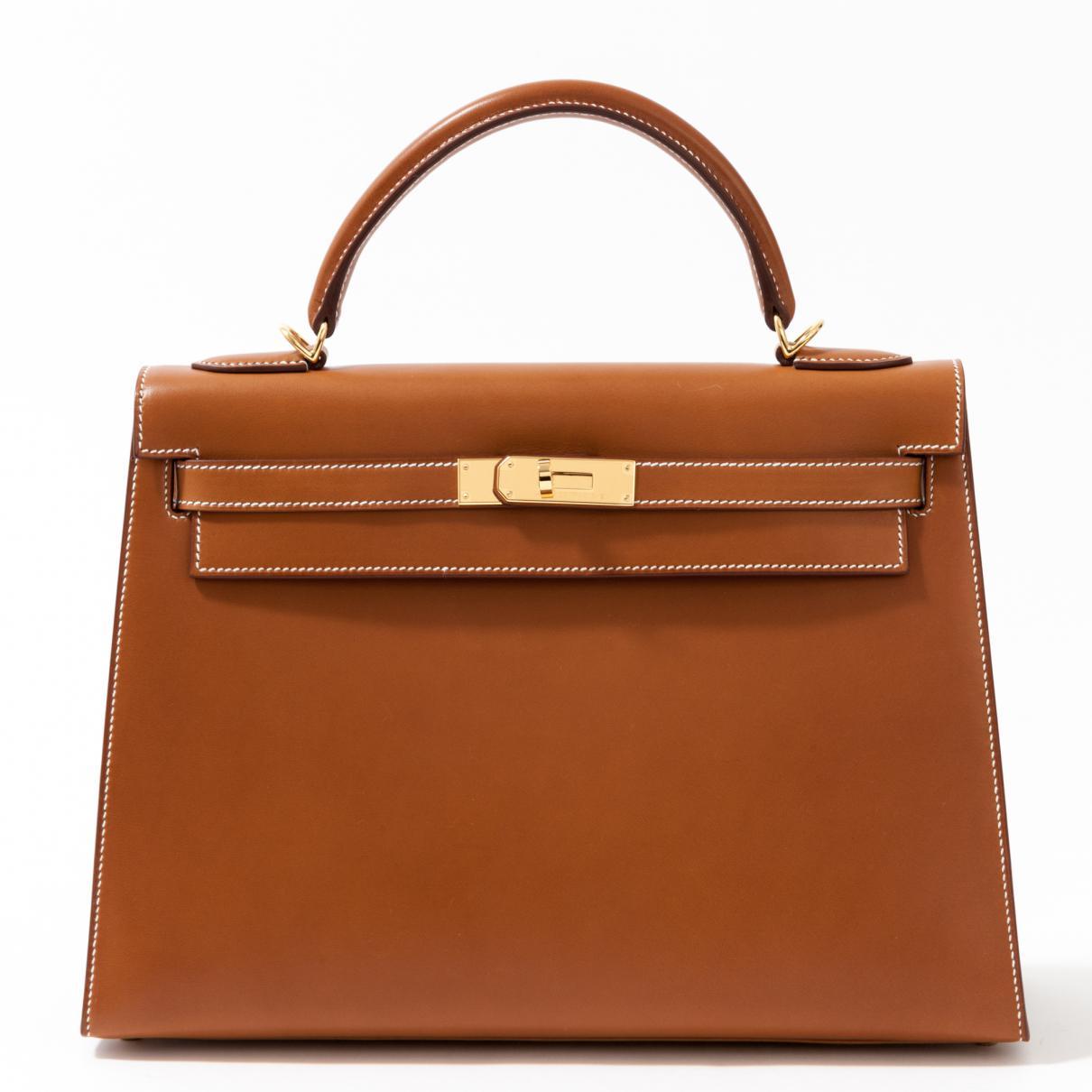 fea5f52cc4 Hermès Kelly 32 Leather Handbag in Brown - Lyst