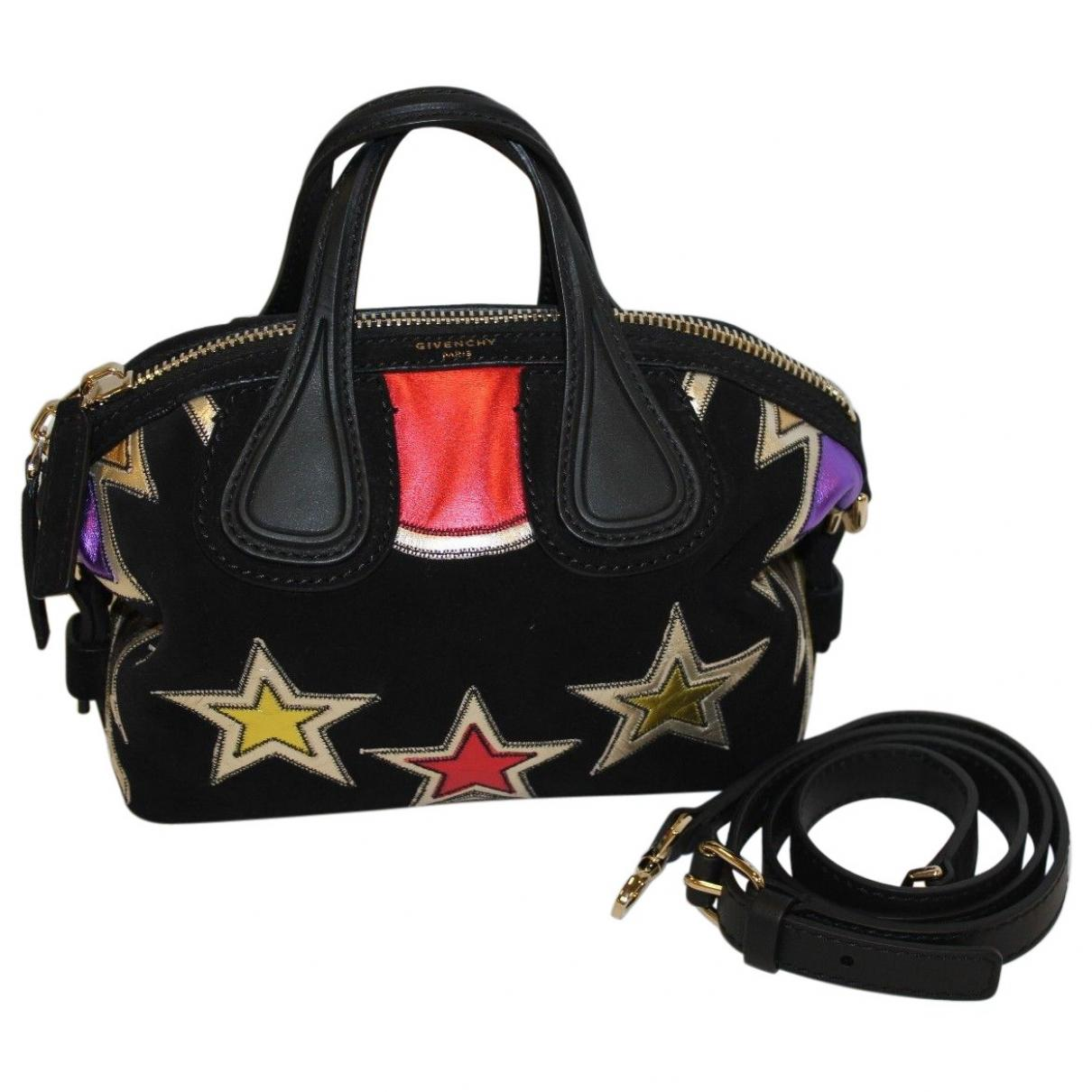 Lyst - Givenchy Pre-owned Nightingale Mini Bag in Black 1a06db5ae10ce