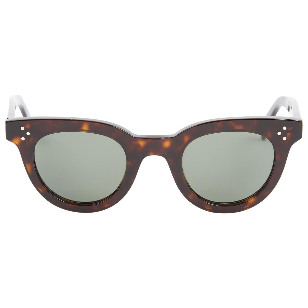 52cd6726ca75b Lyst - Céline Pre-owned Brown Plastic Sunglasses in Brown