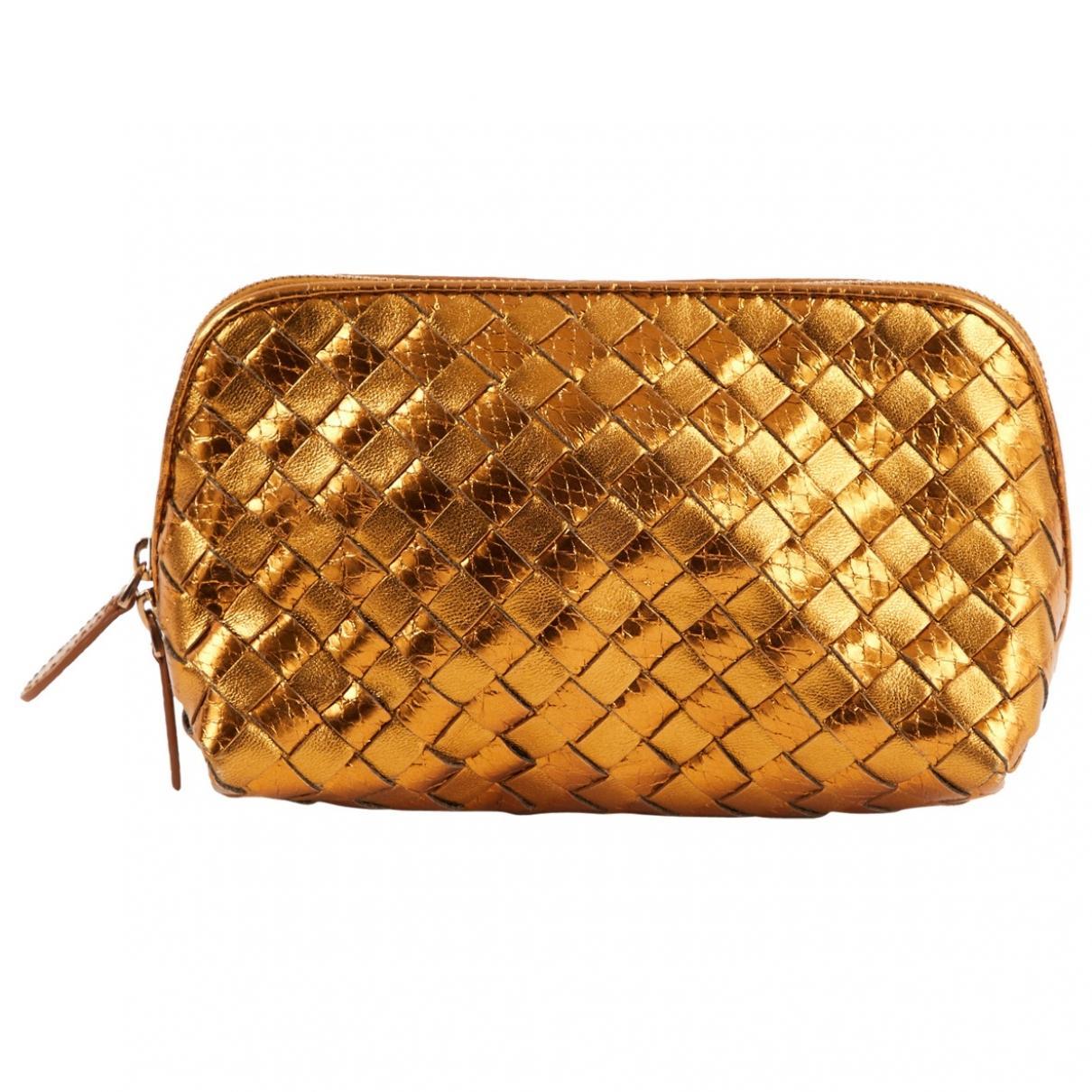 effe70e003 Lyst - Bottega Veneta Pre-owned Gold Leather Clutch Bags in Metallic