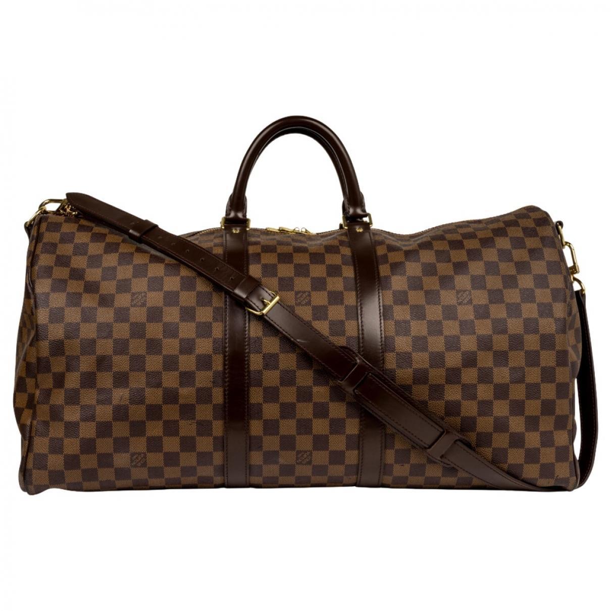 93311b16569 Sac de voyage Keepall en toile Louis Vuitton pour homme en coloris Brown