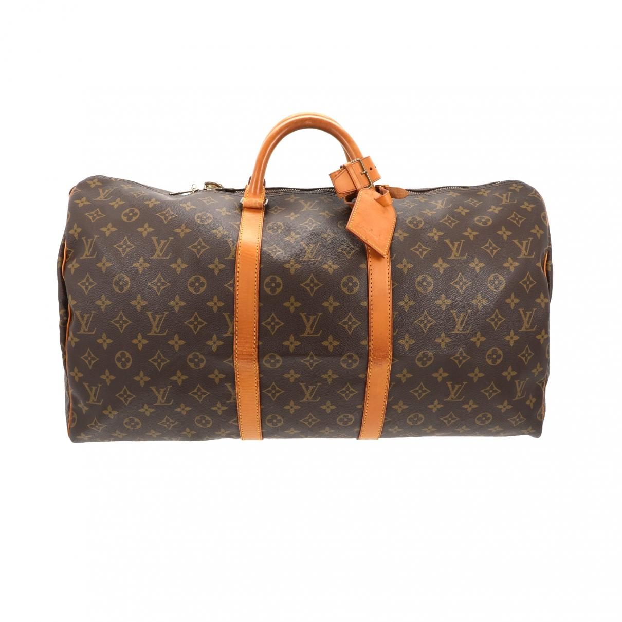 cb617bc51745 Lyst - Louis Vuitton Pre-owned Keepall Brown Leather Travel Bags in ...