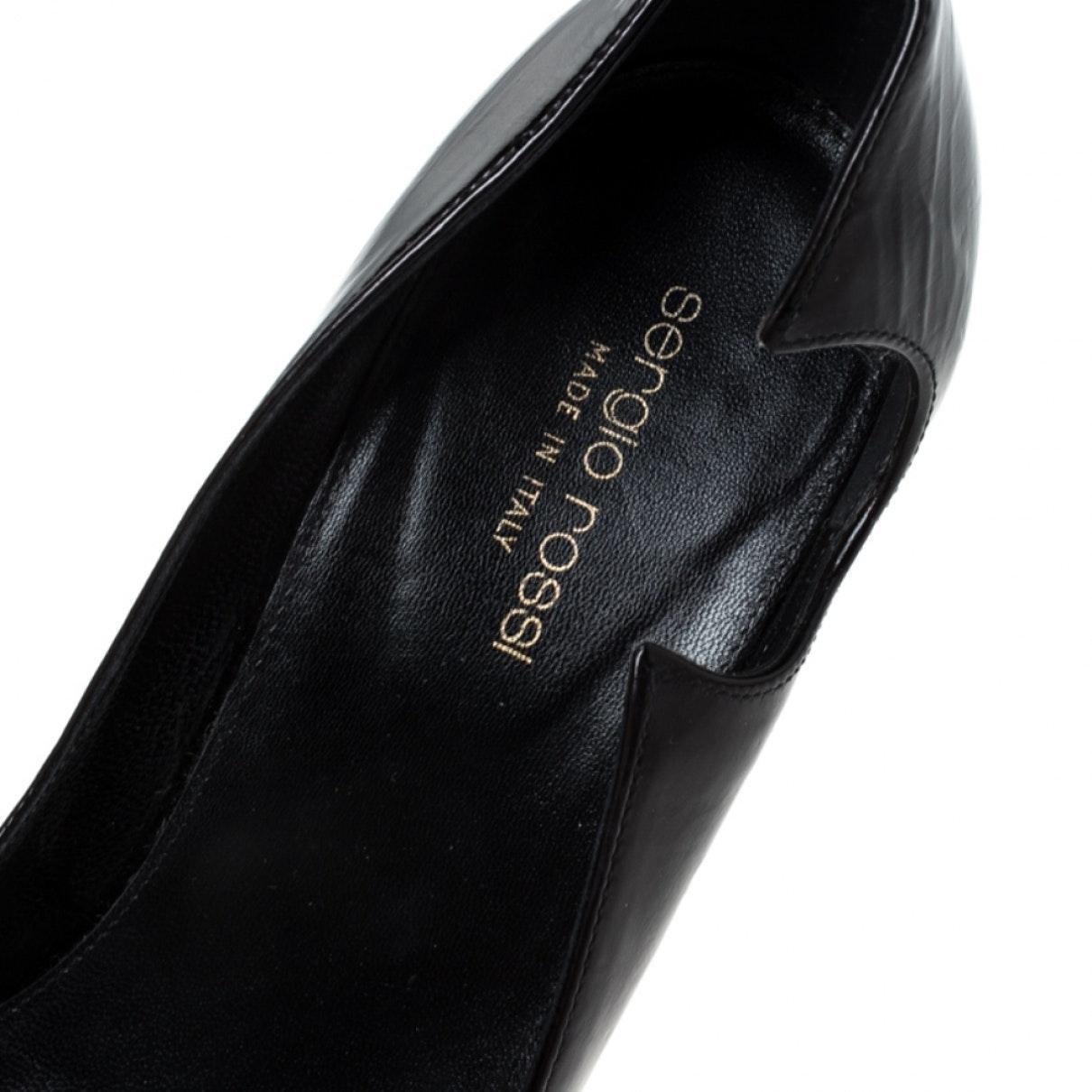 Tacones en charol negro Sergio Rossi de Cuero de color Negro