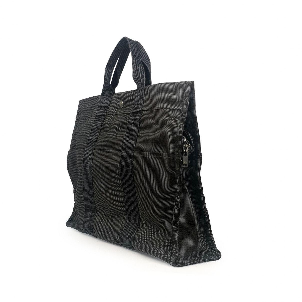 Sac à main Herline en Toile Noir Hermès en coloris Noir fkV6