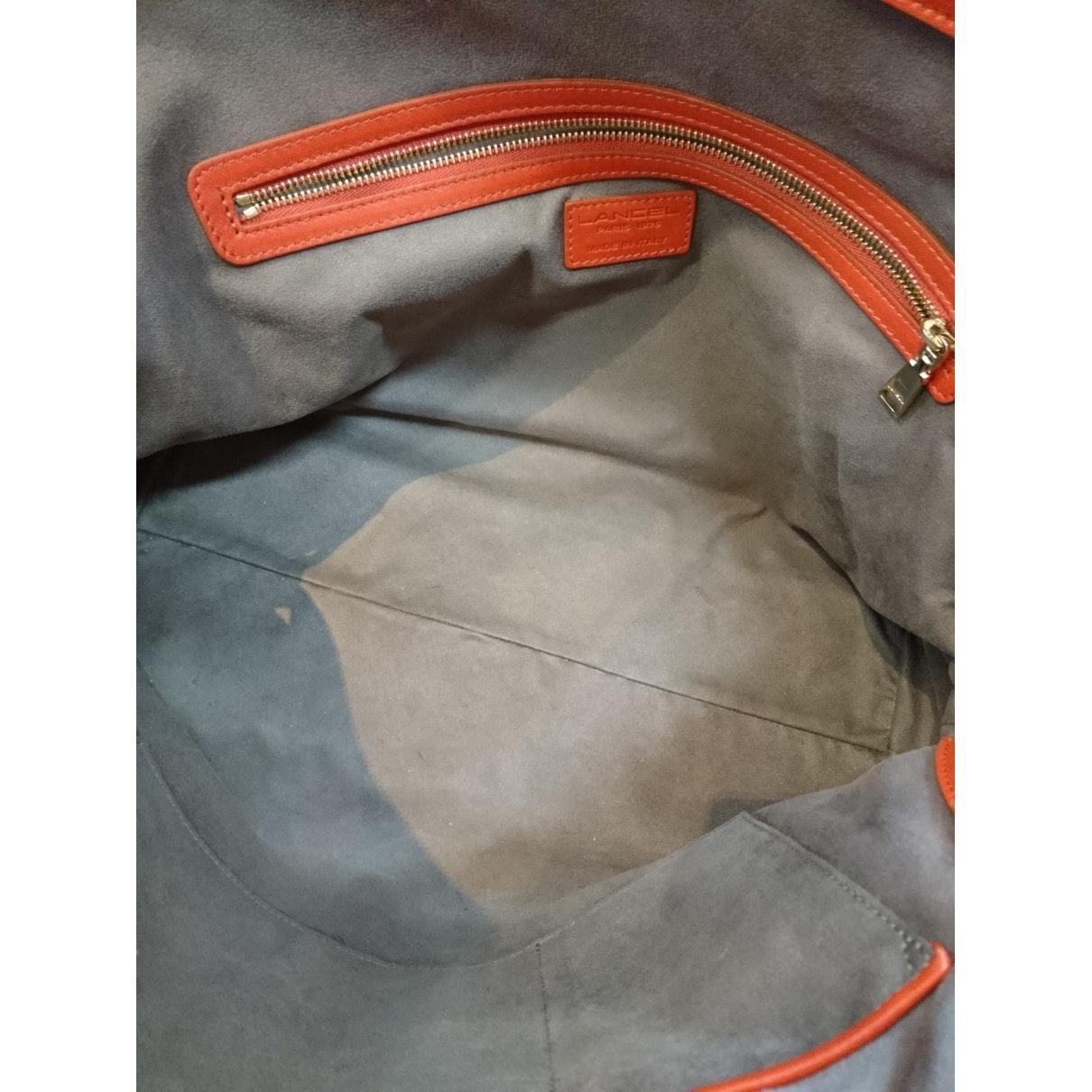 Lancel Leder Leder Handtaschen in Orange ODMO8