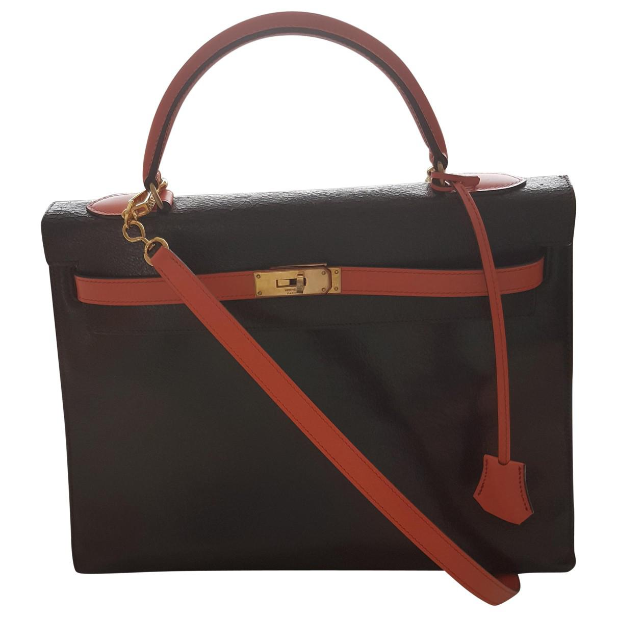 03b3ca53e84f ... cheapest lyst hermès pre owned kelly leather crossbody bag in black  597eb 49e05