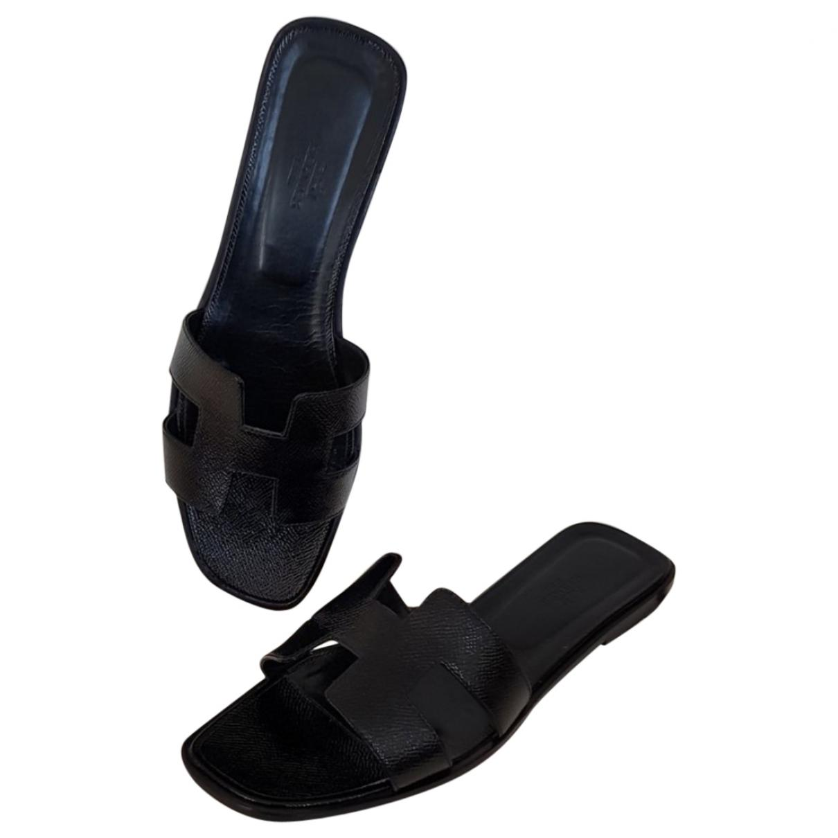 Hermès Oran Patent Leather Mules in