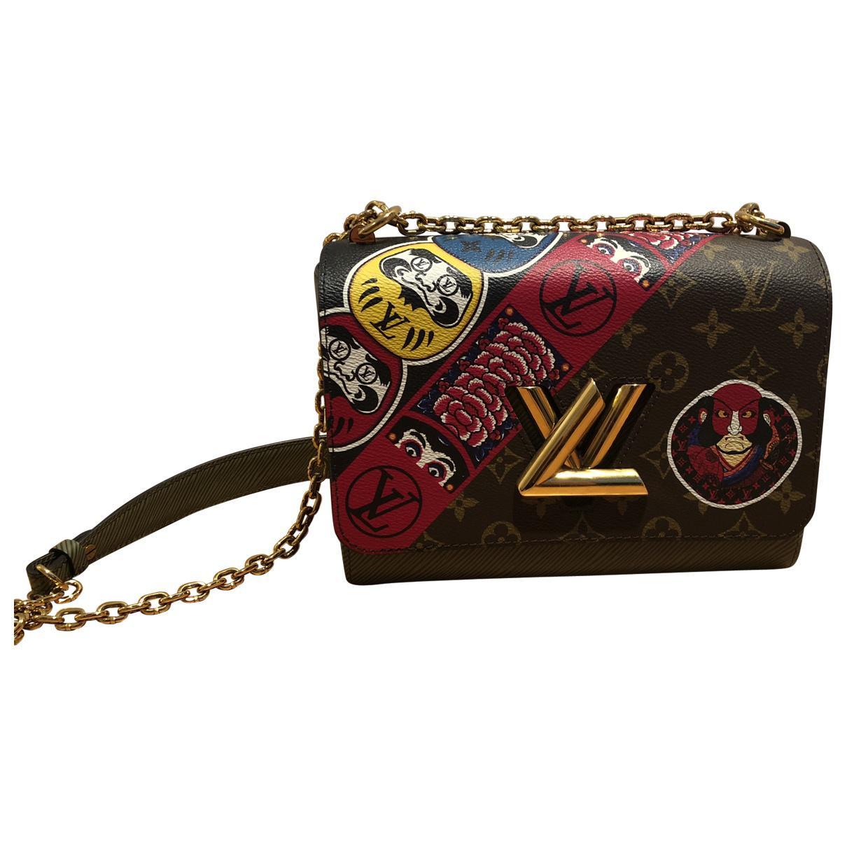 Louis Vuitton Pre-owned - Twist cloth handbag 4CgudYArB