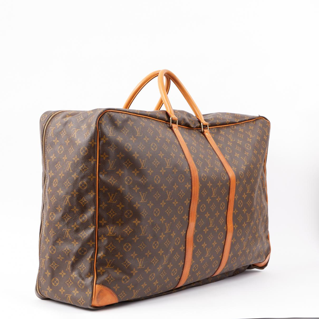 Louis Vuitton Leather Travel Bag in Brown - Lyst