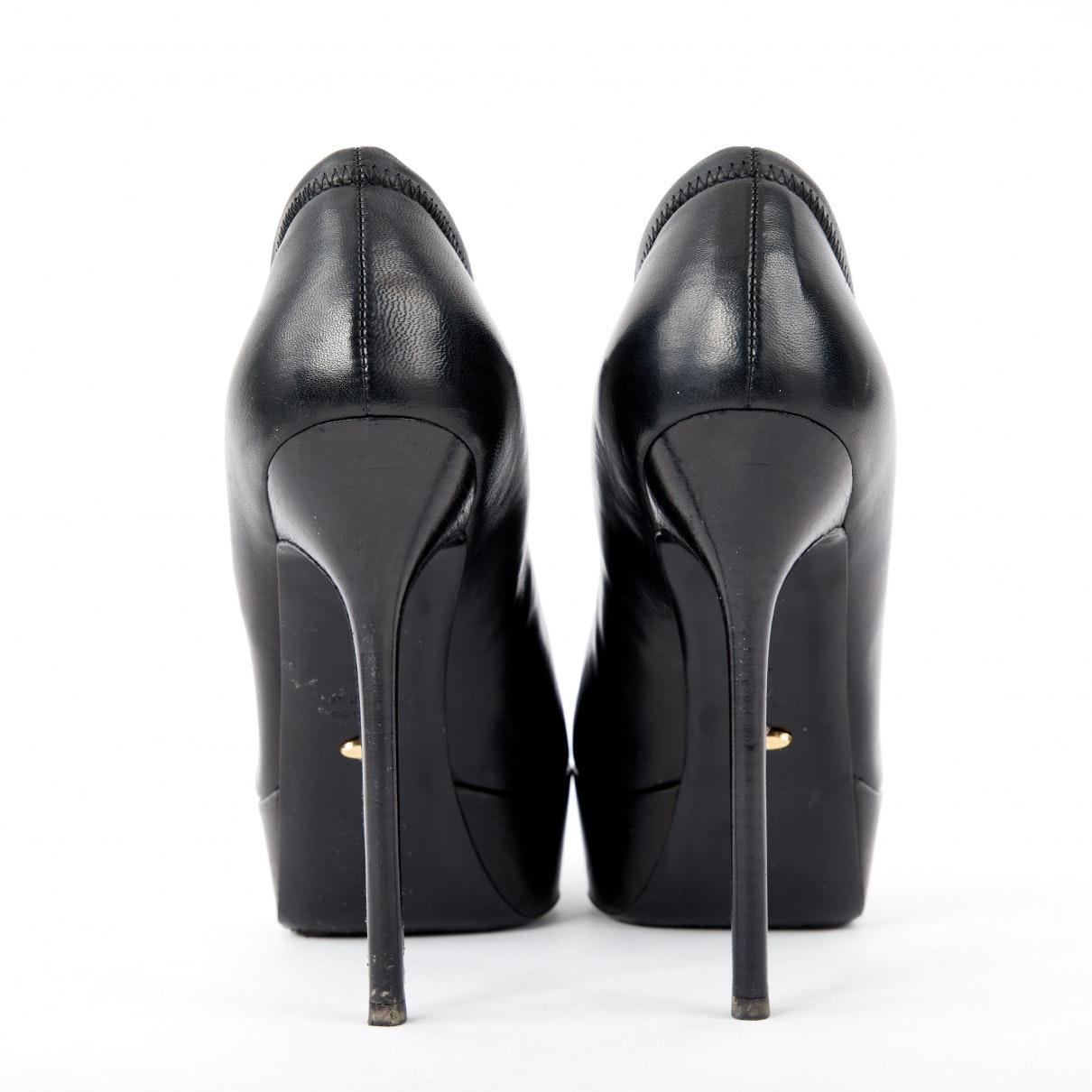 Tacones en cuero negro Sergio Rossi de Cuero de color Negro