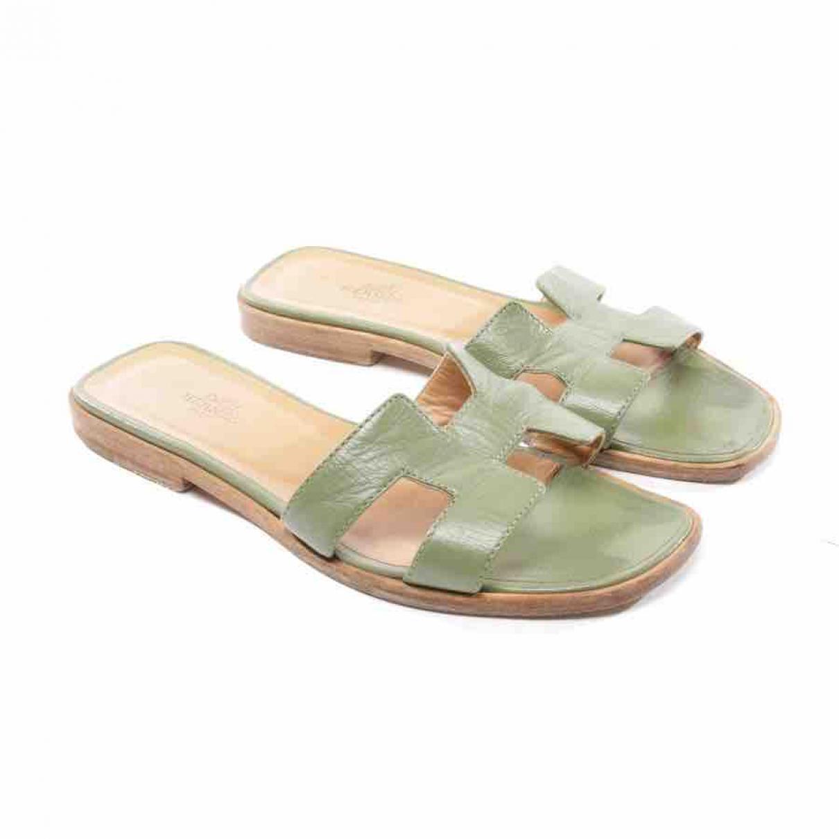 1296395dfcb3 Lyst - Hermès Oran Leather Mules in Green