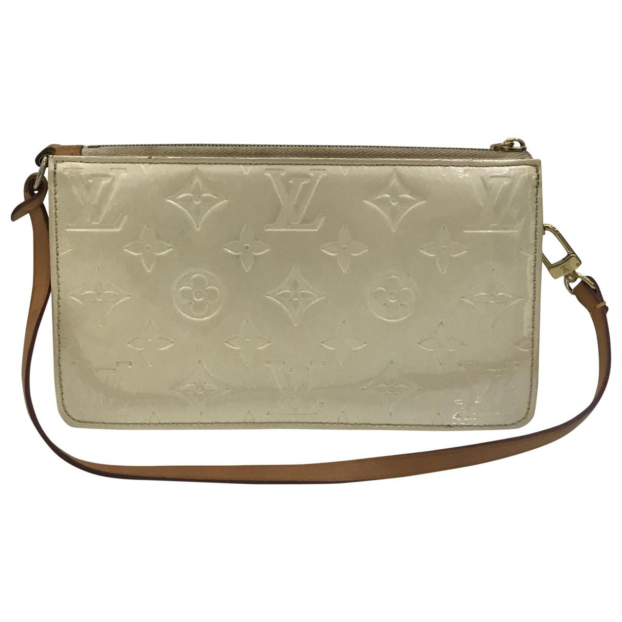 fccd9237d Lyst - Louis Vuitton Patent Leather Handbag in Natural