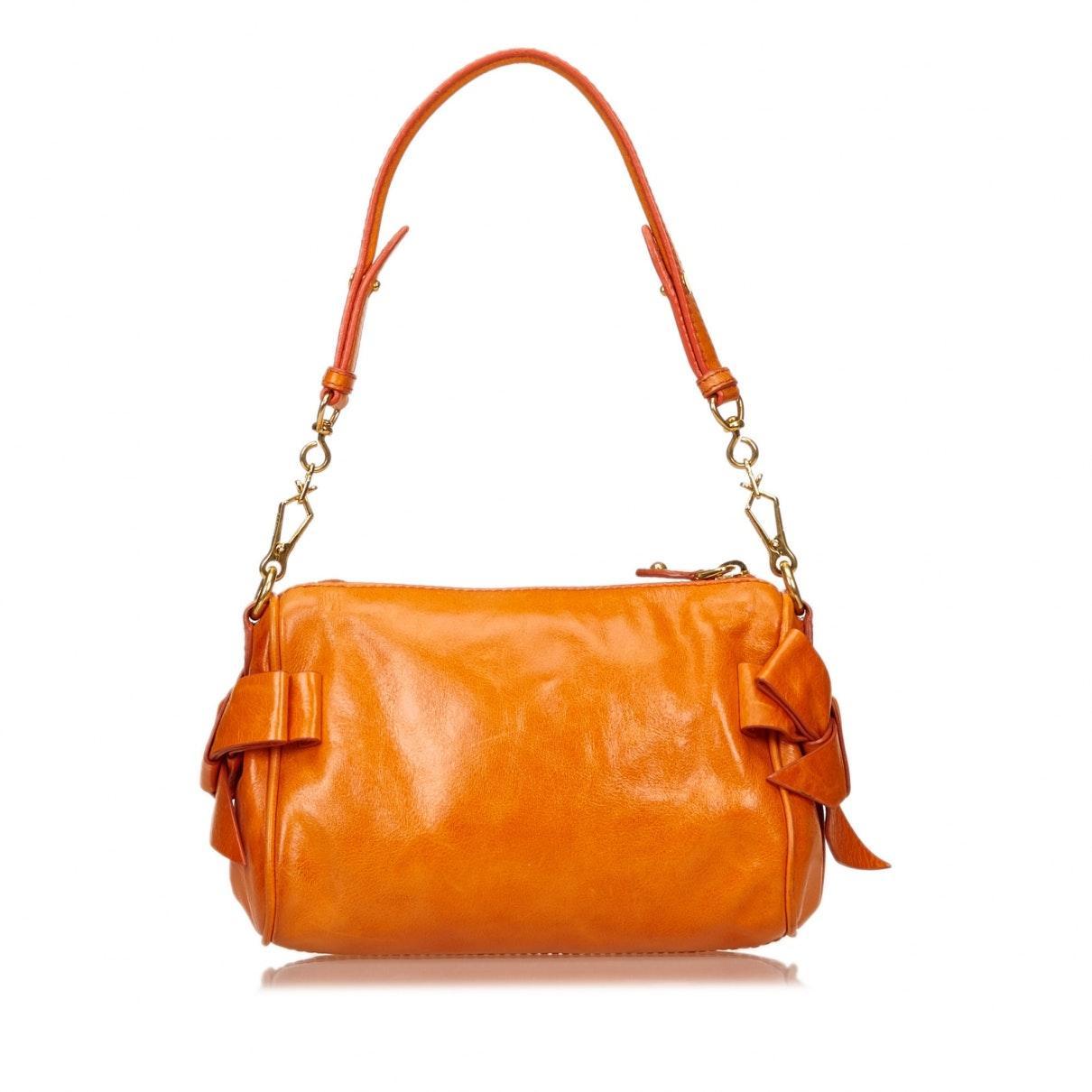 Sacs à main Cuir Miu Miu en coloris Orange BvHy