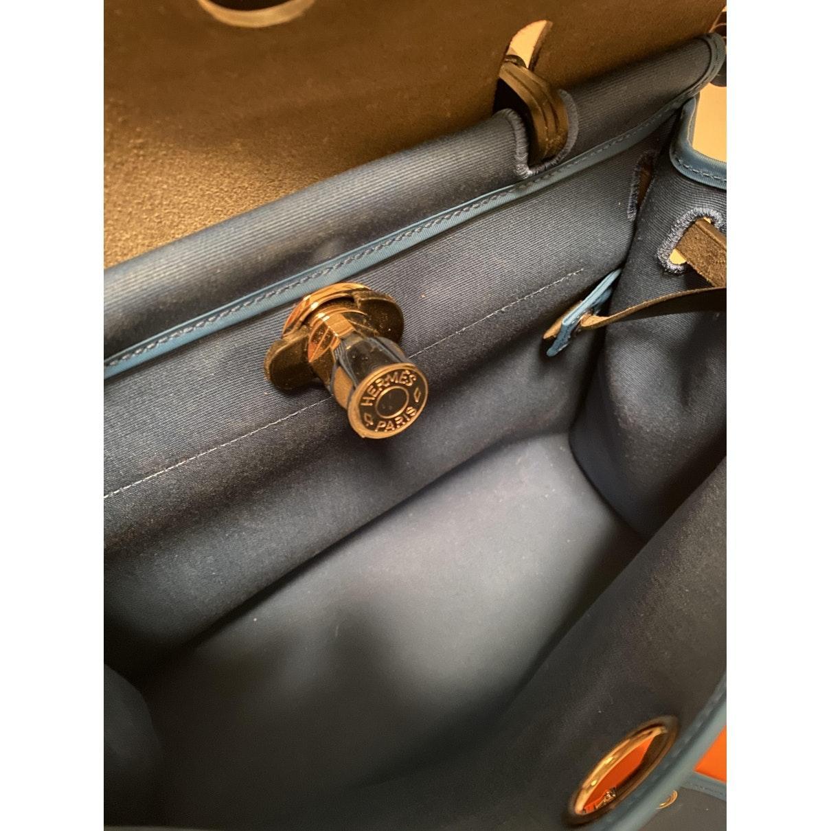 Hermès Herbag Leinen Handtaschen in Blau ZyCez