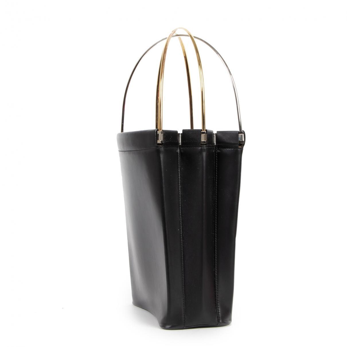 Sac à main Trinity en cuir Cartier en coloris Noir OFMd