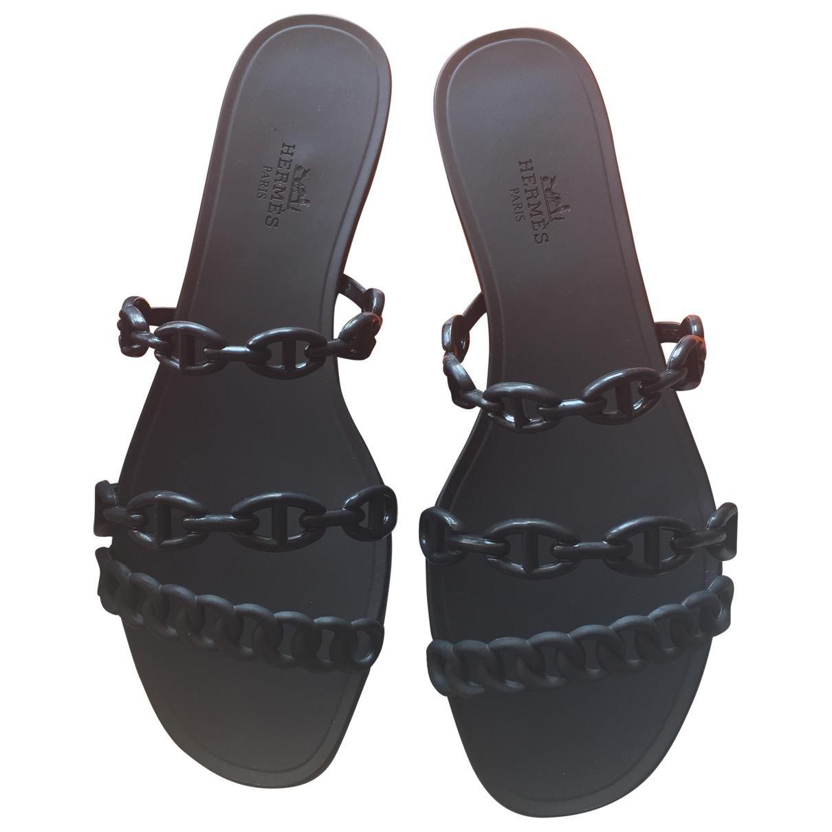 dd1143c13490 Hermès. Women s Nude Black Rubber Sandals.  508  452 From Vestiaire  Collective