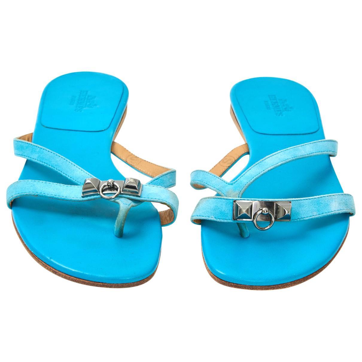 da317bc61cbe50 Lyst - Hermès Pre-owned Corfou Sandals in Blue