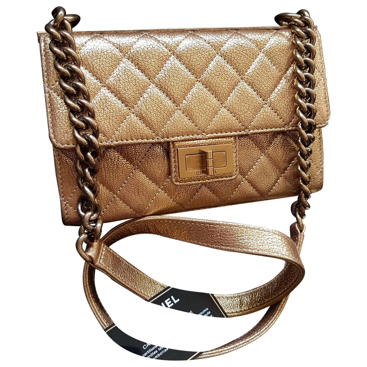 7e13db52217e Lyst - Chanel Pre-owned Gold Leather Handbags in Metallic