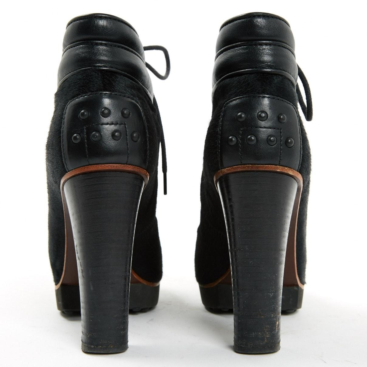 Botines en piel de potro de imitación negro N Tod's de Cuero de color Negro