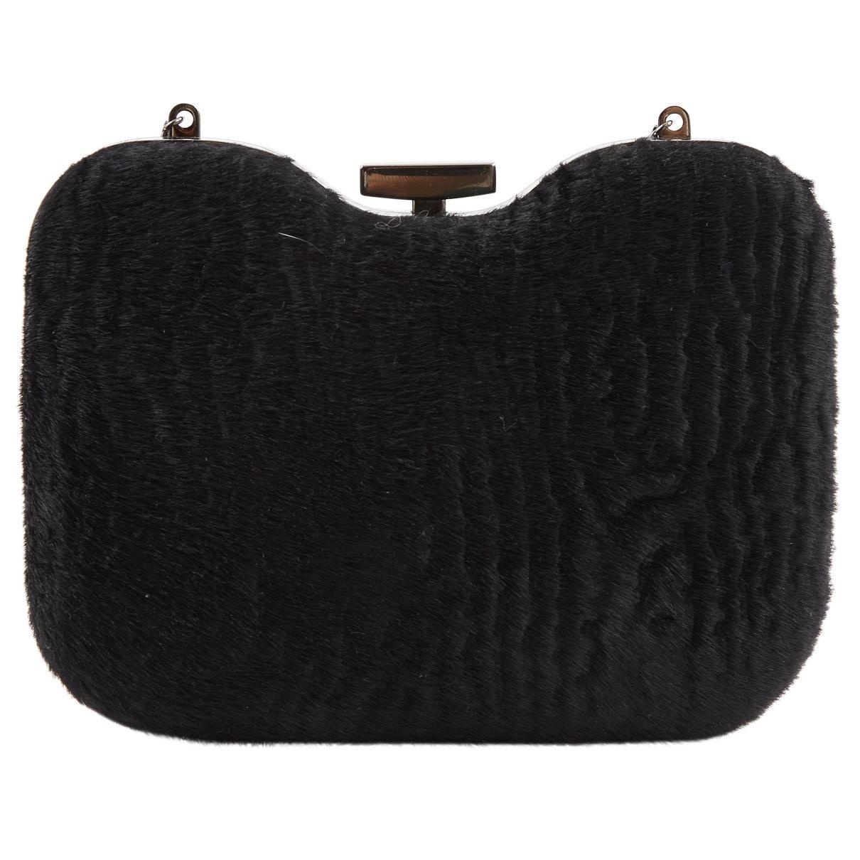 4527287fc465 Lyst - Fendi Pre-owned Black Pony-style Calfskin Clutch Bags in Black