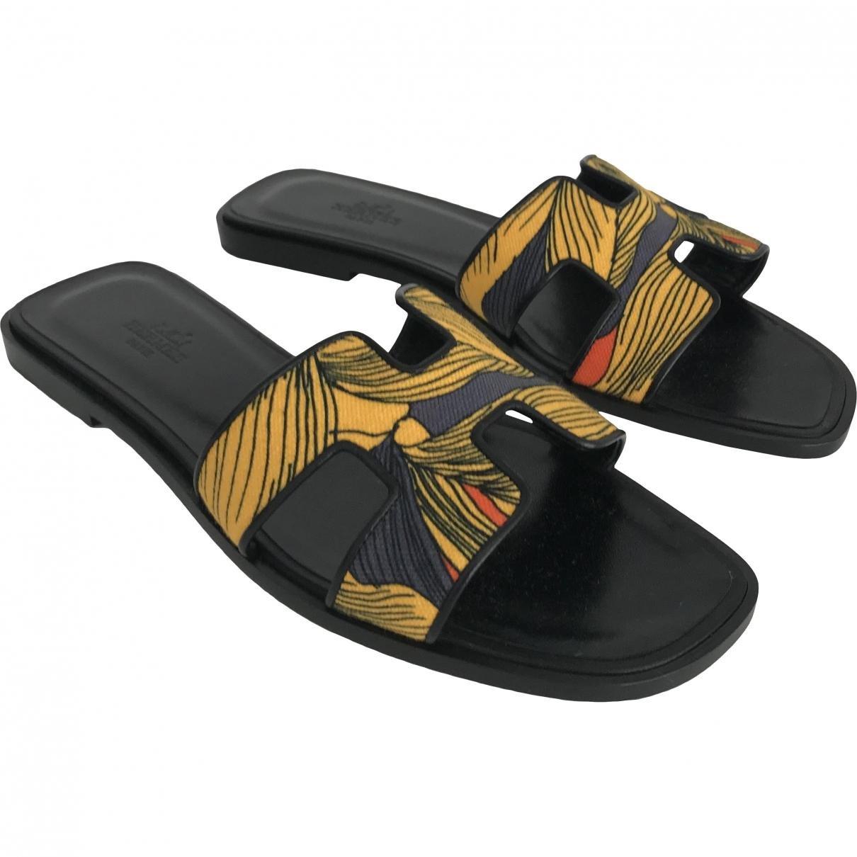 a41e3f2d200c Lyst - Hermès Pre-owned Oran Multicolour Leather Sandals in Black