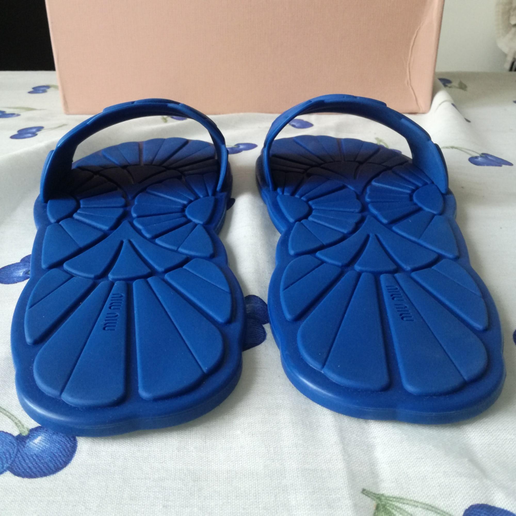 Mules caoutchouc bleu Miu Miu en coloris Bleu
