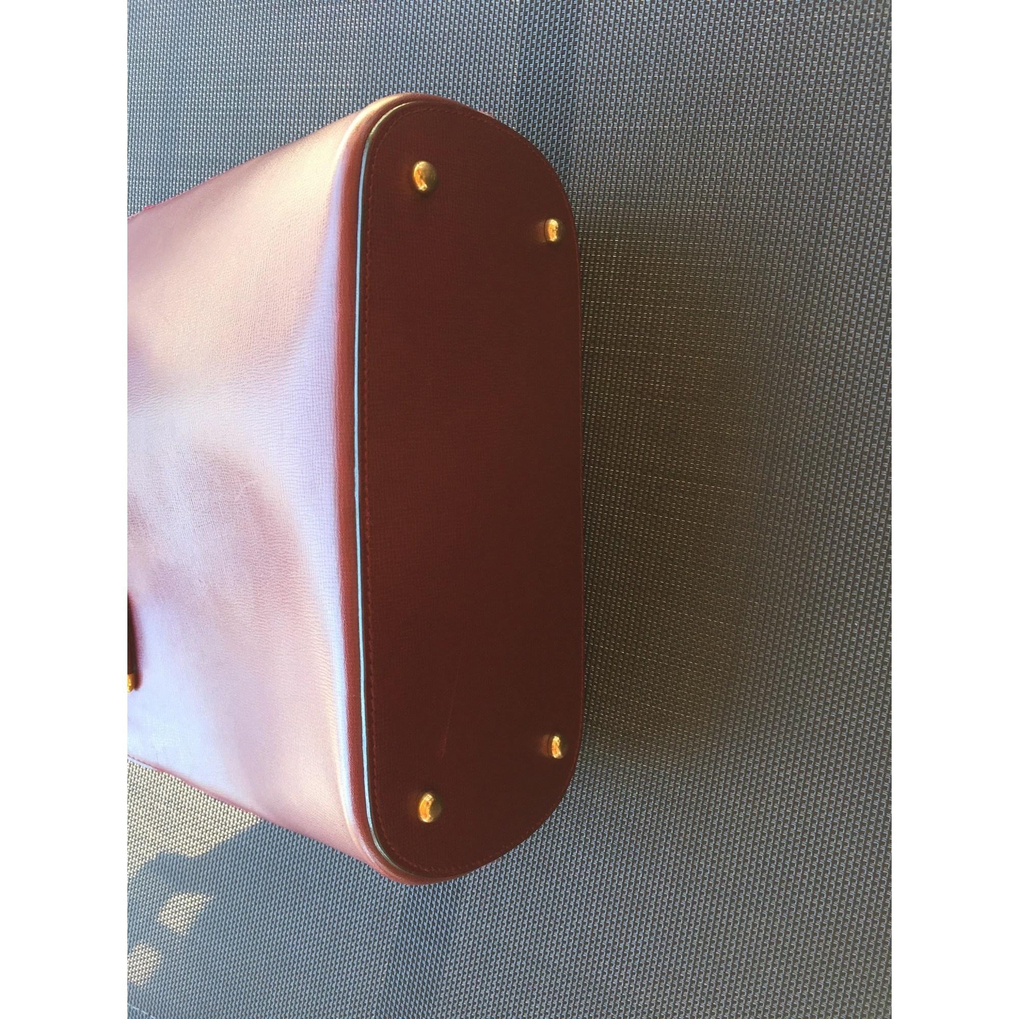 Sac à main en cuir cuir rouge Cartier en coloris Rouge 5UKr