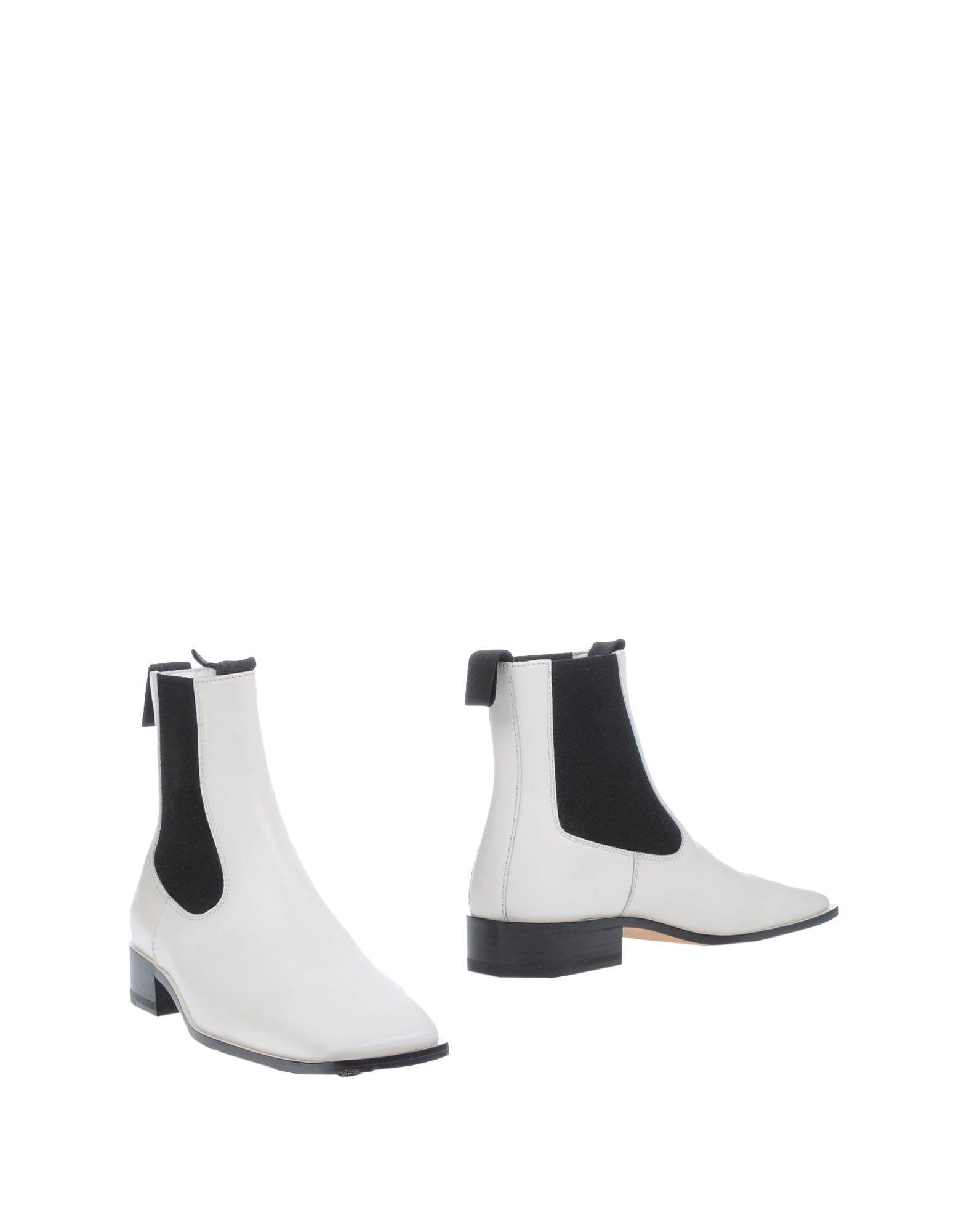 Celine Leather Ankle Boots in White - Lyst