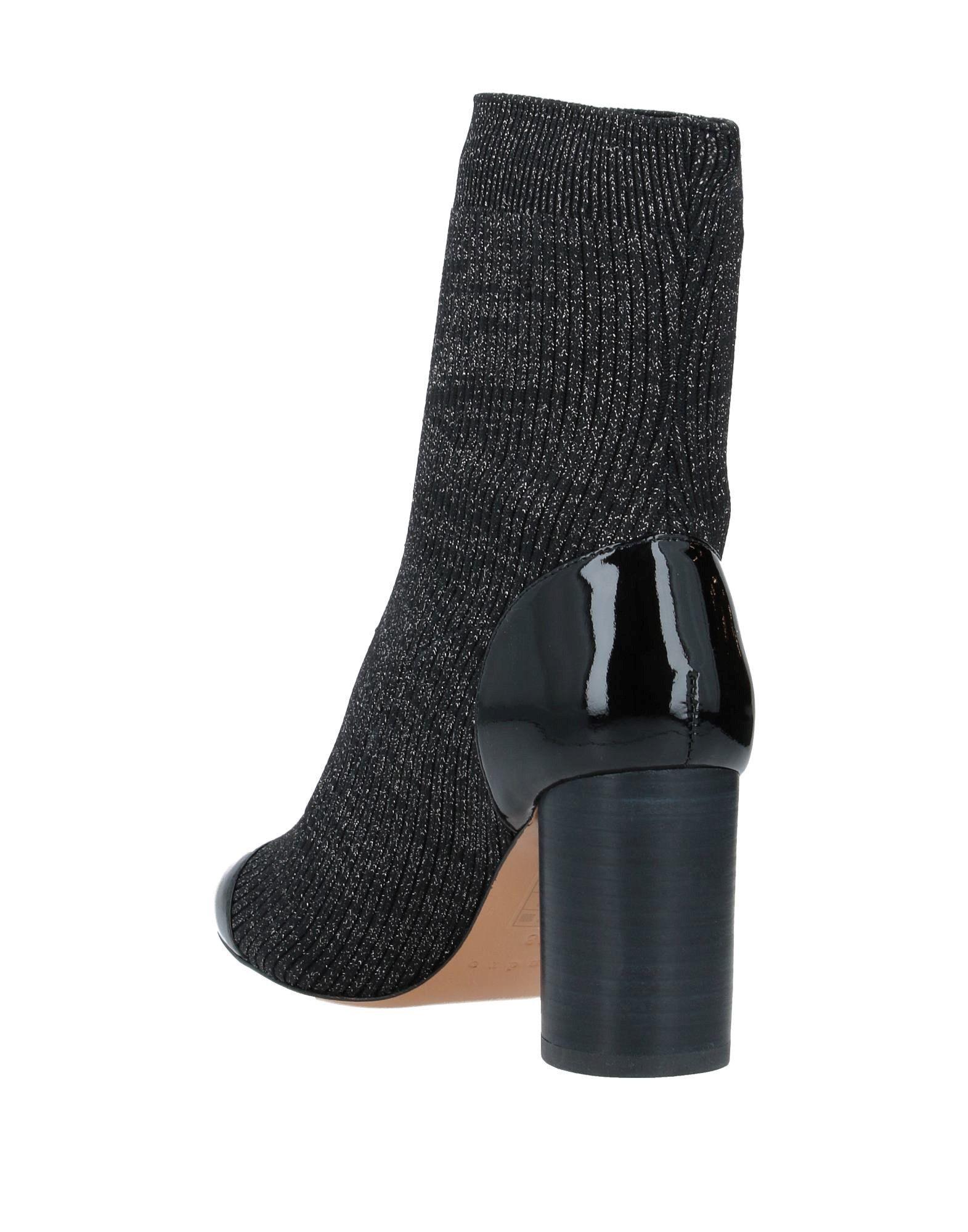 Botines de caña alta Sandro de Cuero de color Negro
