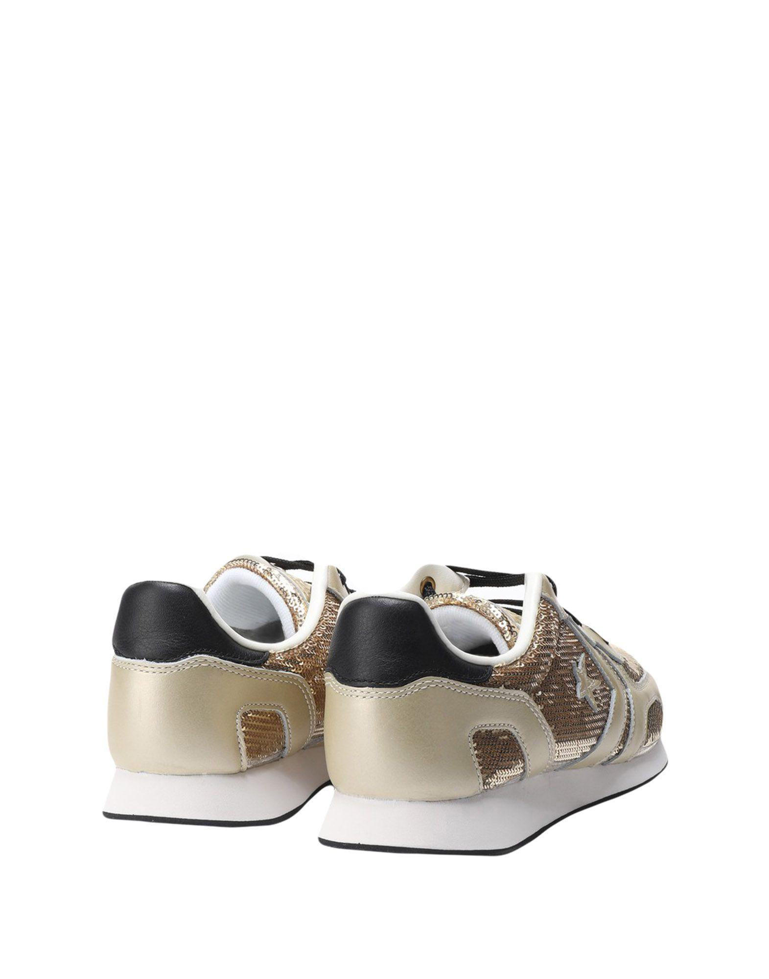 Converse Leather Low-tops & Sneakers in Gold (Metallic)