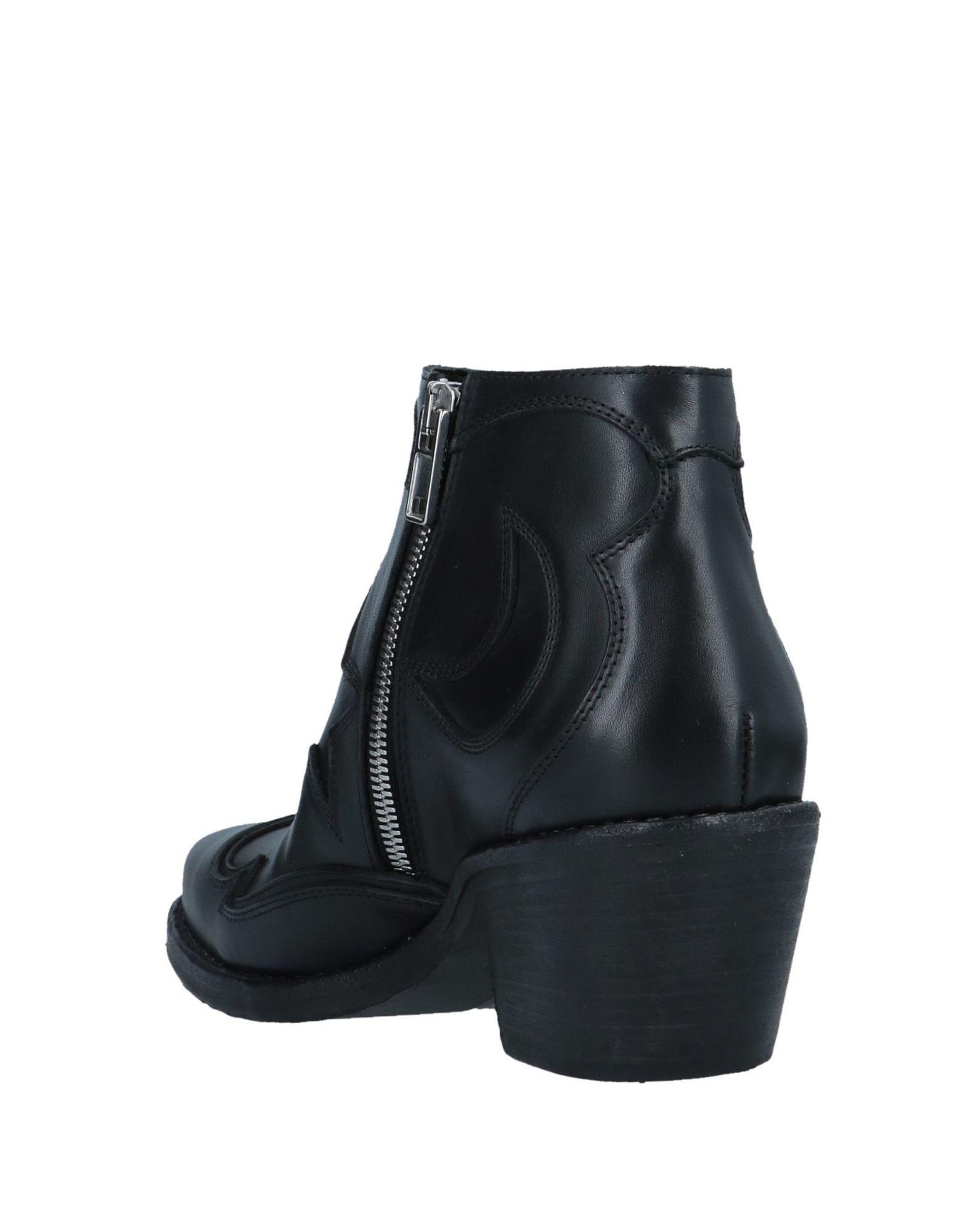 Botines de caña alta McQ de Cuero de color Negro