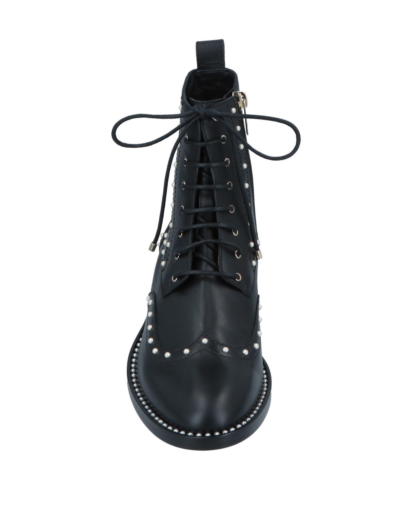 Botines de caña alta Jimmy Choo de Cuero de color Negro