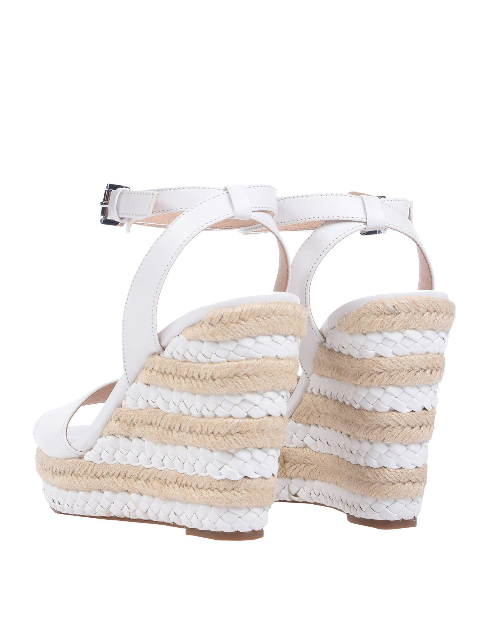 d94a899fa14e Lyst - Michael Michael Kors Sandals in White