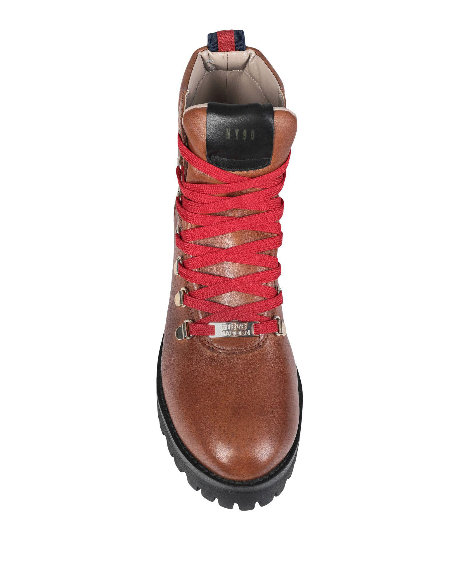 Botines de caña alta Steve Madden de Caucho de color Marrón