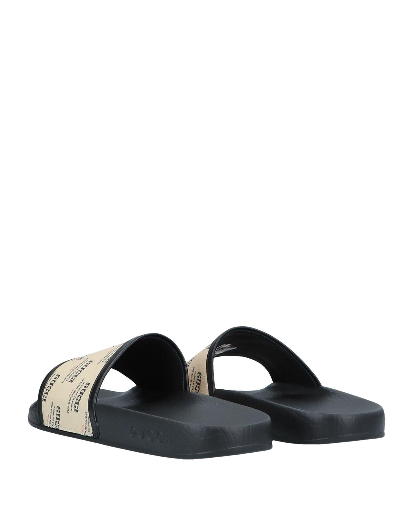 4eed1079cdbab8 Lyst - Gucci Logo Print Rubber Slide Sandals in Natural - Save 35%